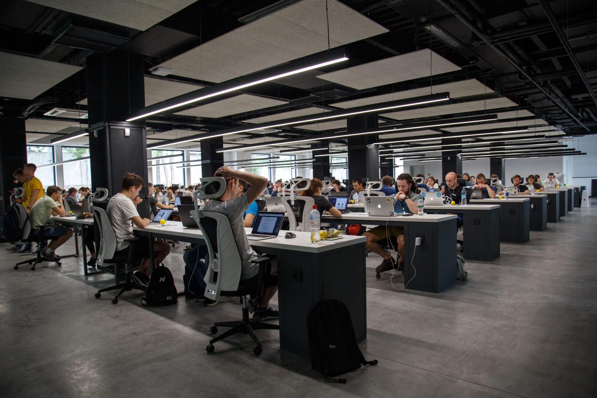 group of people at computers in large room