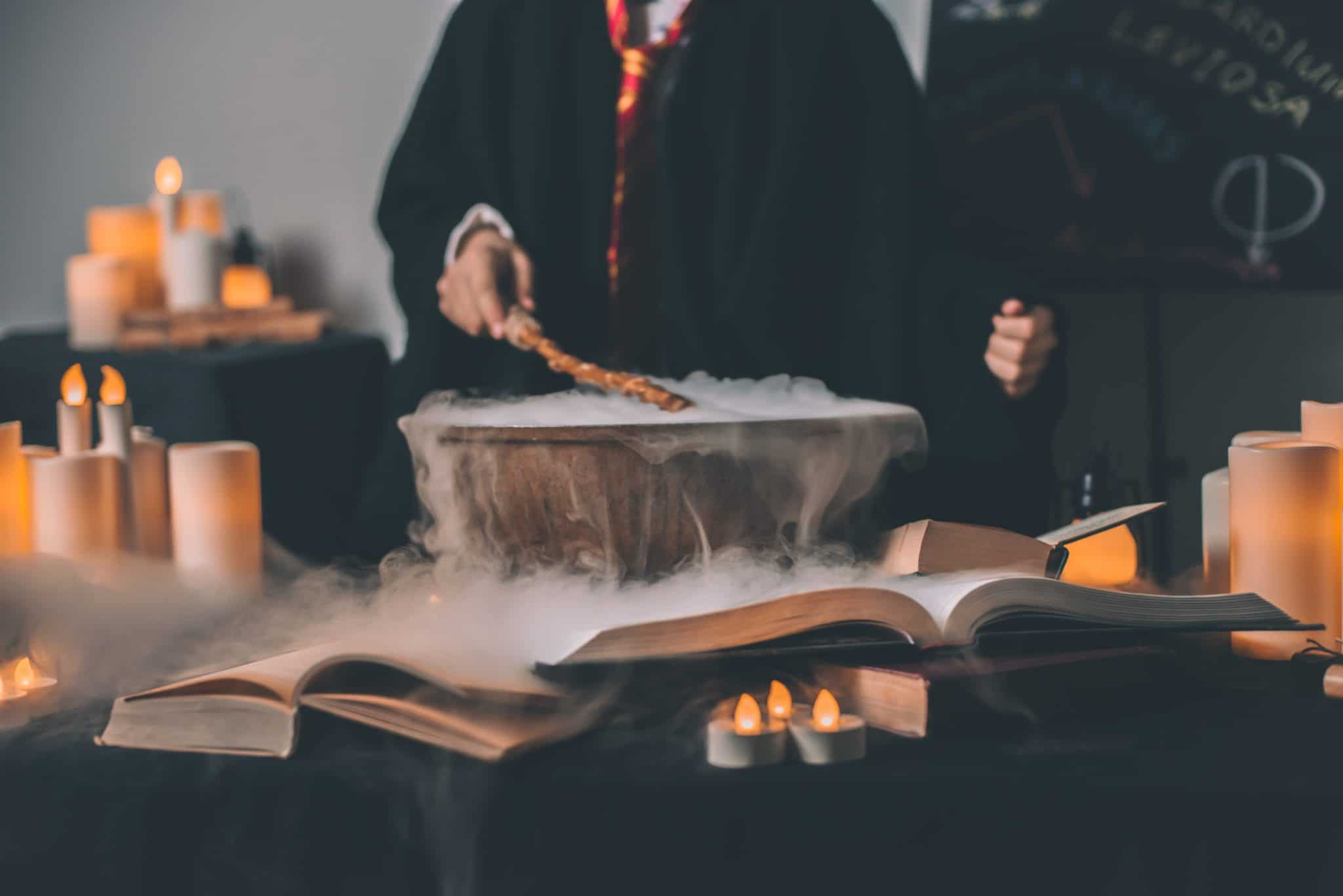 magician working spell over cauldron