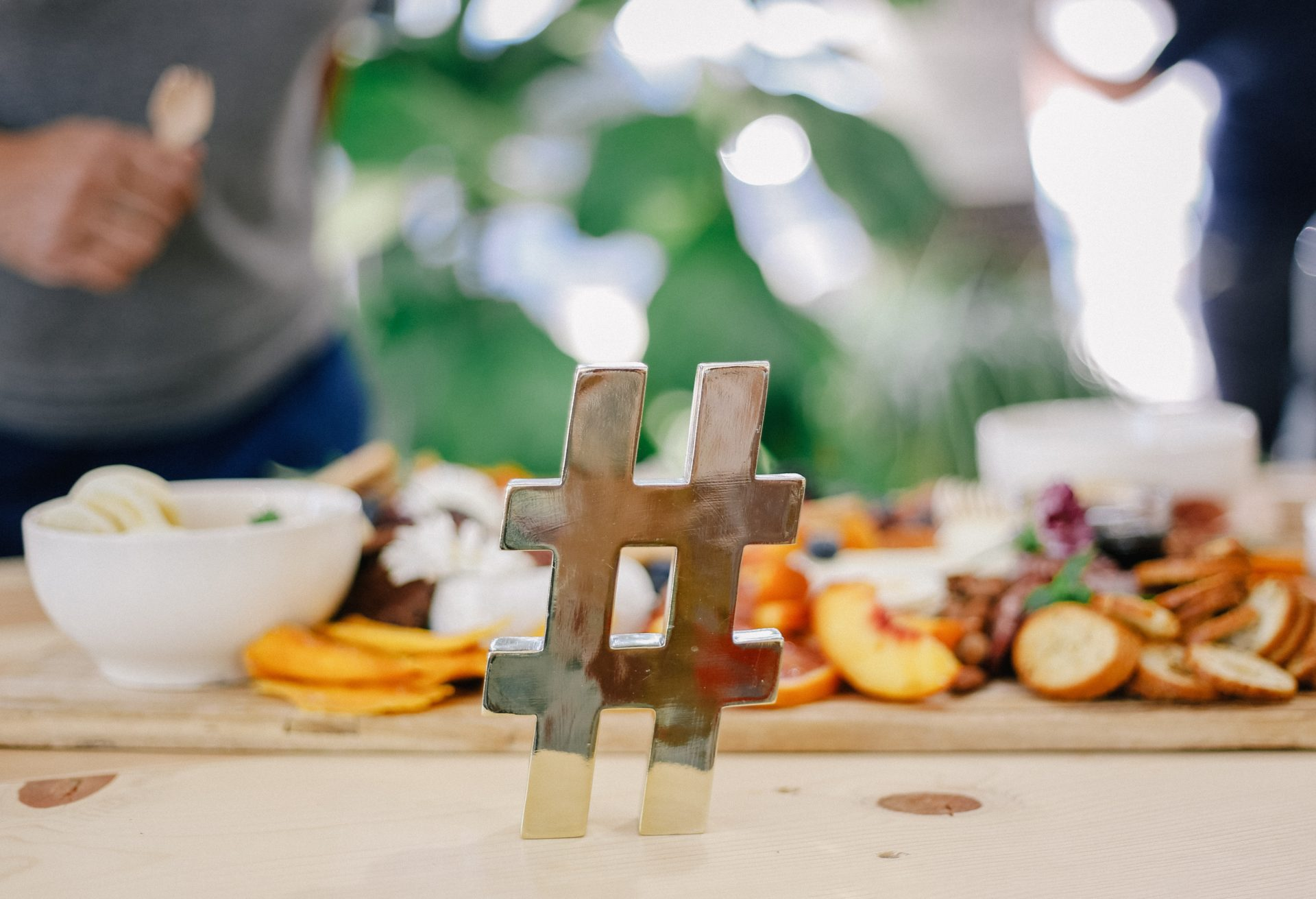silver hashtag in front of people cooking