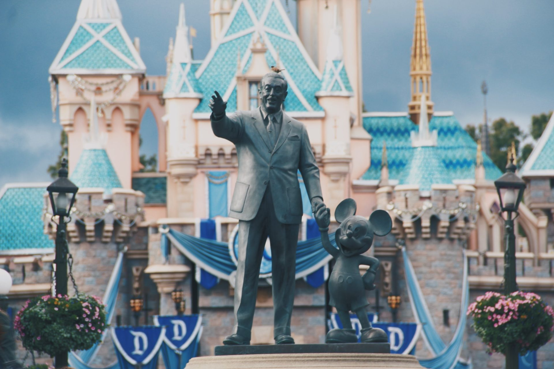 statues of Walt Disney and Mickey Mouse in front of Cinderella's castle