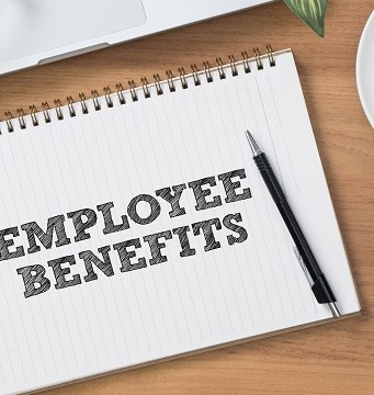 pen and pad reading employee benefits